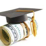 mini graduation cap on a roll of money